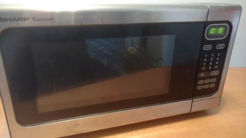 Never-Used Microwave. $30 OBO.